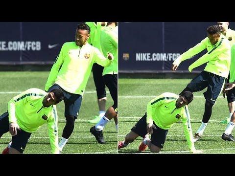 Neymar Kicks Luis Suarez On The Backside During Barcelona Training Session