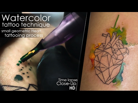 Watercolor tattoo technique - small geometric Heart - tattooing process Time lapse Close Up Full HD