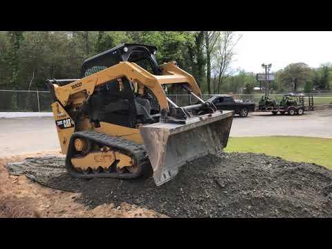 Cat 259d Spreading Gravel