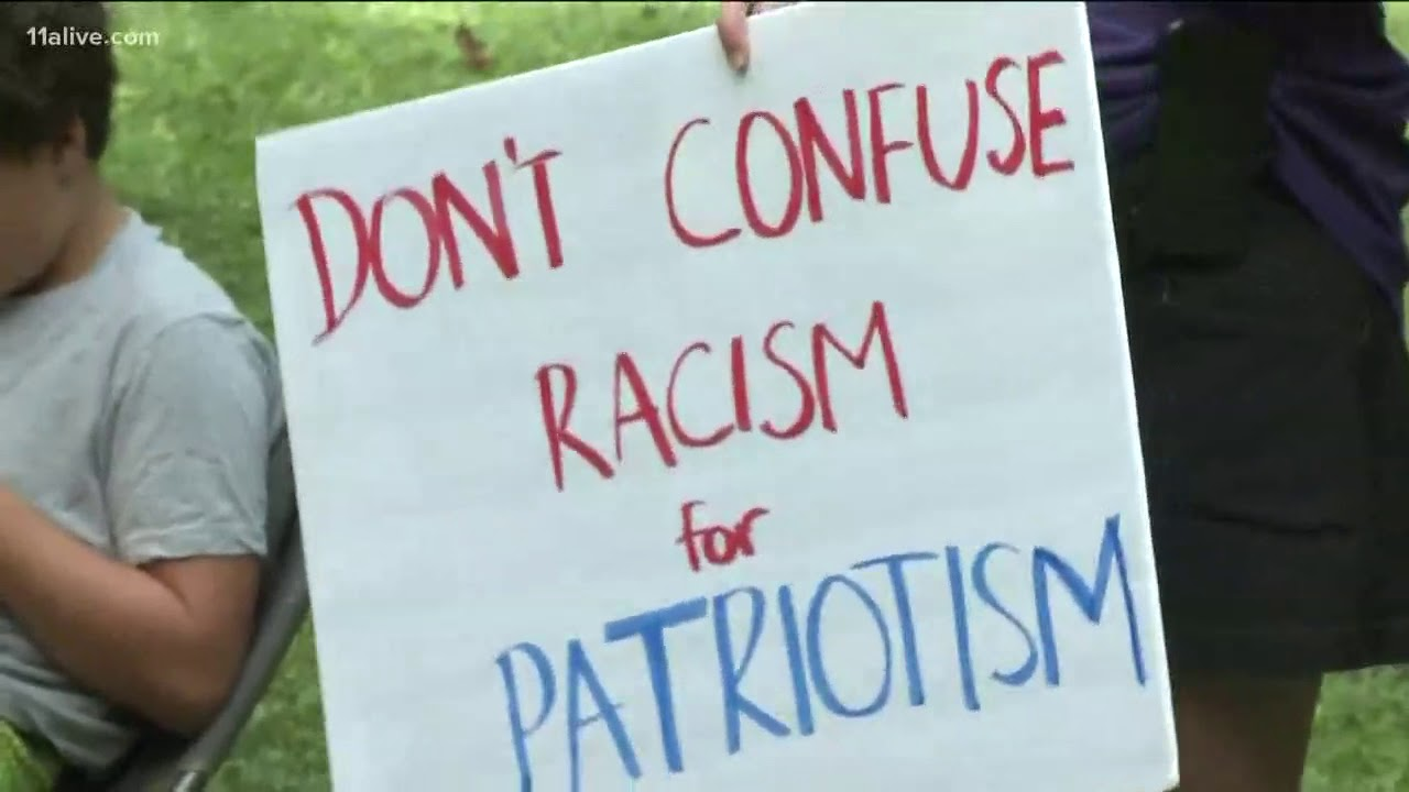 Rally held in Piedmont Park in support of athletes protesting police brutality