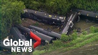 Aerial video shows fiery train derailment as massive flooding hits central Texas