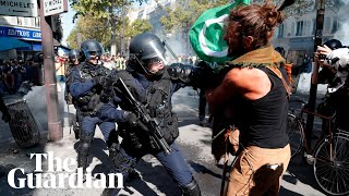 Riot police fire teargas at protesters as Paris demonstrations turn violent