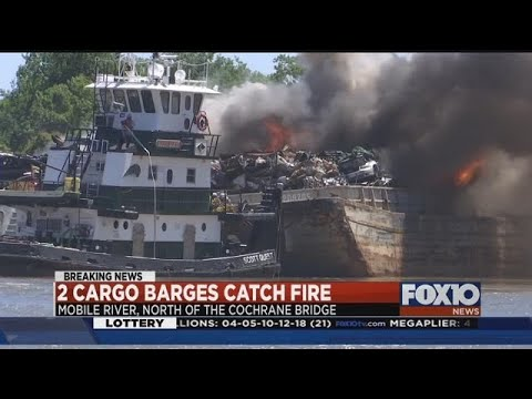 Cargo barges catch fire on the Mobile River
