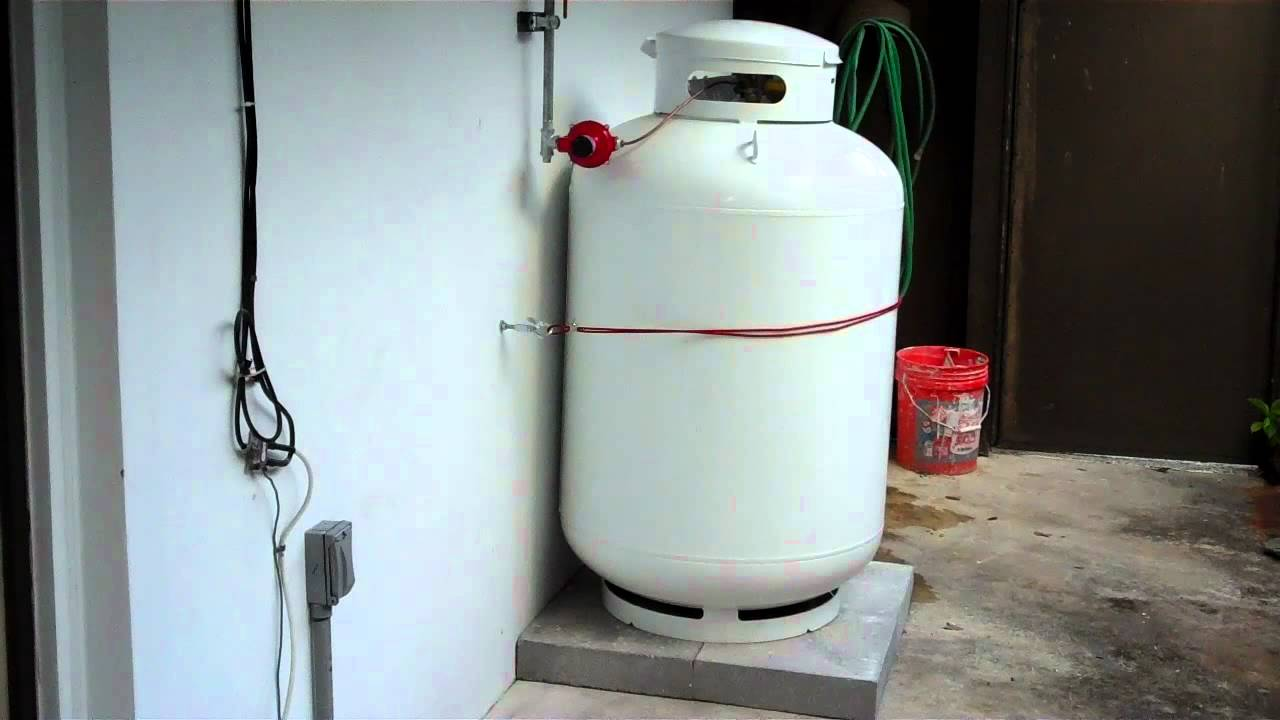 Propane tank and outdoor tankless water heater installation - YouTube