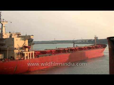 Ship with crane specialized in lifting heavy loads at Paradeep Port