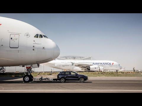 Watch A Porsche Cayenne Tow A 314-Ton Jumbo Jet