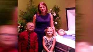Mom Poses with Kids at Husband