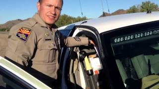 Arizona DPS Police Officer M. Conner charges Robert Trudell as Arizona Resident w/ California Plate
