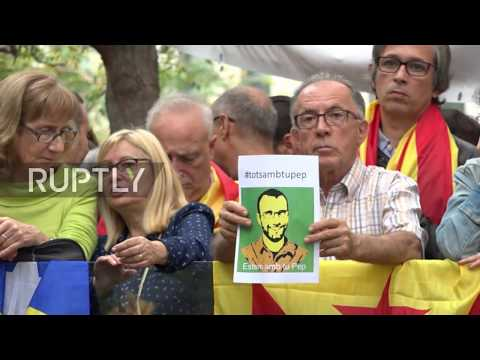 Spain: 'Voting is not a crime!' - Catalan protesters decry officials' arrests in Barcelona