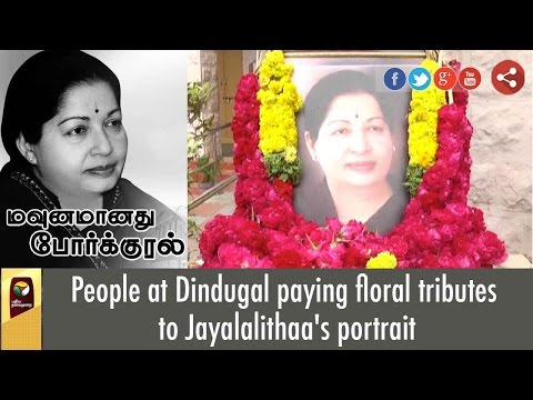 People at Dindugal paying floral tributes to Jayalalithaa's portrait