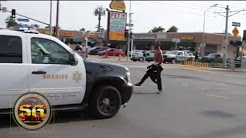 Man on PCP challenges police vehicle in South Los Angeles before being arrested