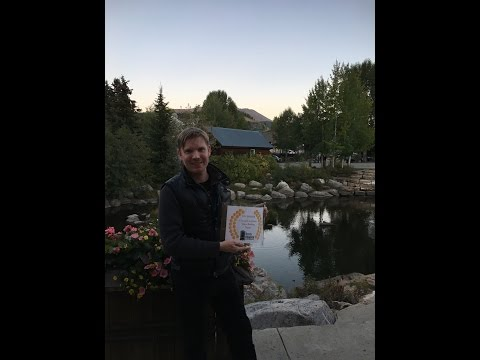 Hunter Lee Hughes accepting award from Breck Film Festival