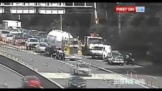 Crazy Sydney Driver makes U-Turn on M2 Motorway - 11th February 2013