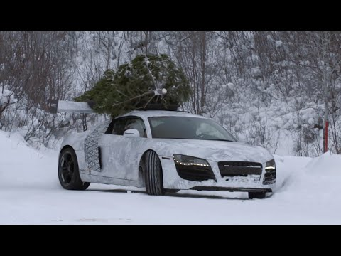 Envision R8 Drifting In Snow With Christmas Tree On Roof