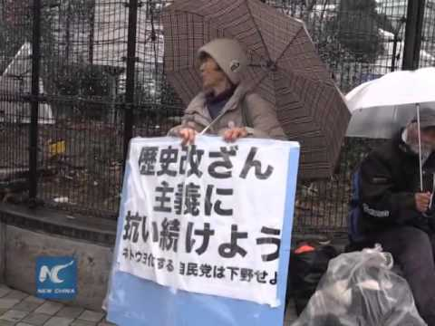 Japanese citizens demand PM face history
