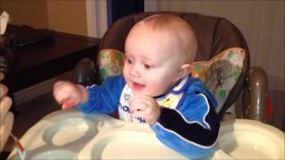 Baby laughing hysterically at ice chewing