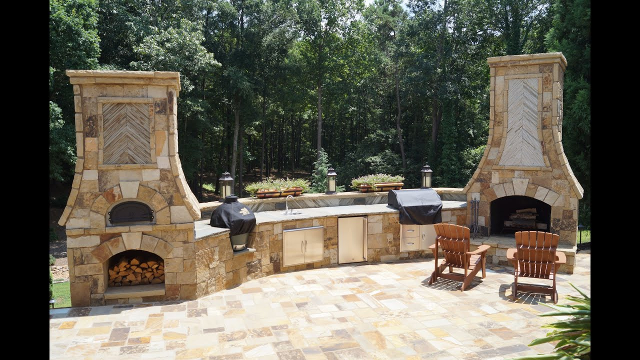 with side water features sierra tuscany and outdoor oven unilock pizza pin fireplace a