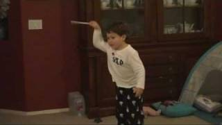 3 year old Jonathan conducting to the 4th movement of Beethoven's 5th Symphony thumbnail