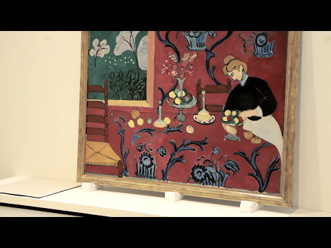 "Behind the scenes: curator Anne Baldassari installing the exhibition ""Icons of Modern Art"""