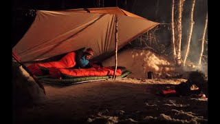 Winter Camping in tнe Wilderness - A Tarp, Sleeping Bags and Sleeping Matts for Shelter.