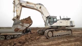 Repeat youtube video Komatsu PC800LC loading trucks and ADT´s