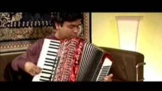 A R Rahman playing accordion