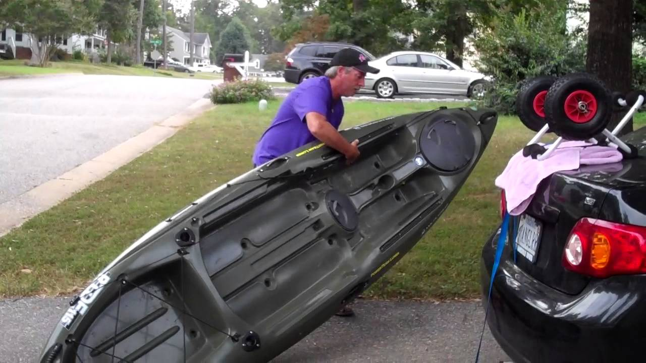 Loading my Kayak onto roof rack Kayak cart - YouTube