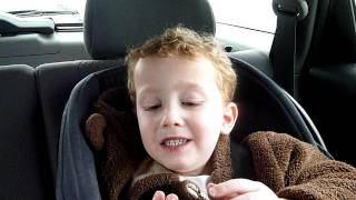 Kid eats a sour candy Warhead