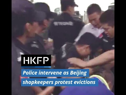 Police respond as shopkeepers protest evictions at Beijing Zoo wholesale market