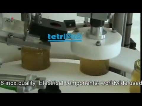 Jars filling capping machine