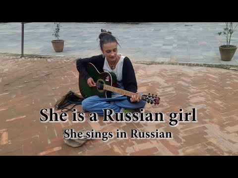 Russian girl singing in Kathmandu with guitar