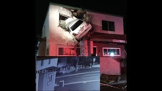 Car goes airborne, slams into 2nd floor of building and stays there