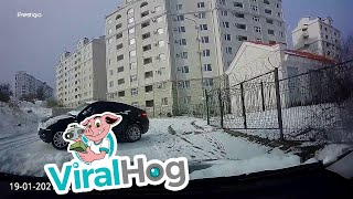 Quick Thinking Driver Reverses Away from Sliding Car || ViralHog