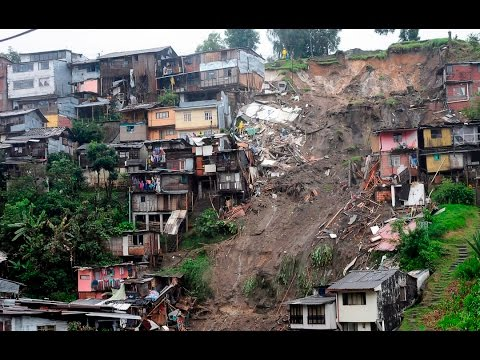 Manizales landslide in Colombia killed at least 17 people , heavy rain , mud and rock