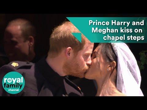 Prince Harry and Meghan Markle kiss on St. George's Chapel steps