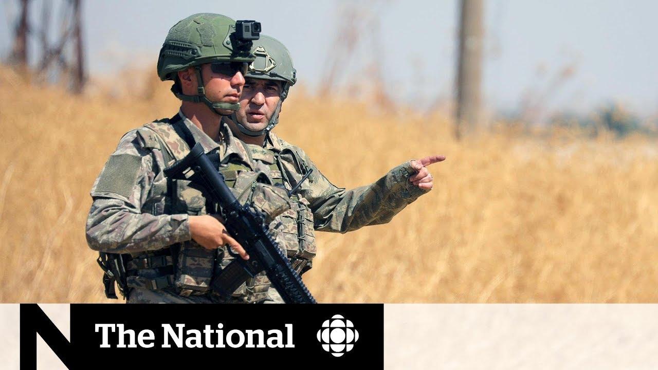 Turkish military gathers at Syrian border