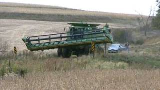 John Deere Combine doing some tricky maneuvering down the road