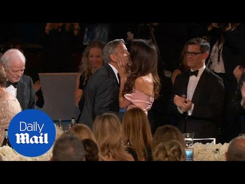 Amal Clooney kisses George as he is honoured by the AFI  Daily Mail