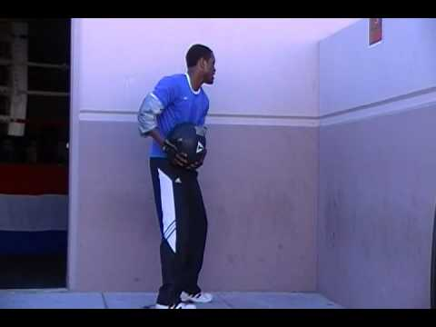 Tracy Rollins Jr. working with the medicine ball