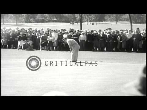 Patricia Jane Berg beats Julius Page in a game of Golf. HD Stock Footage