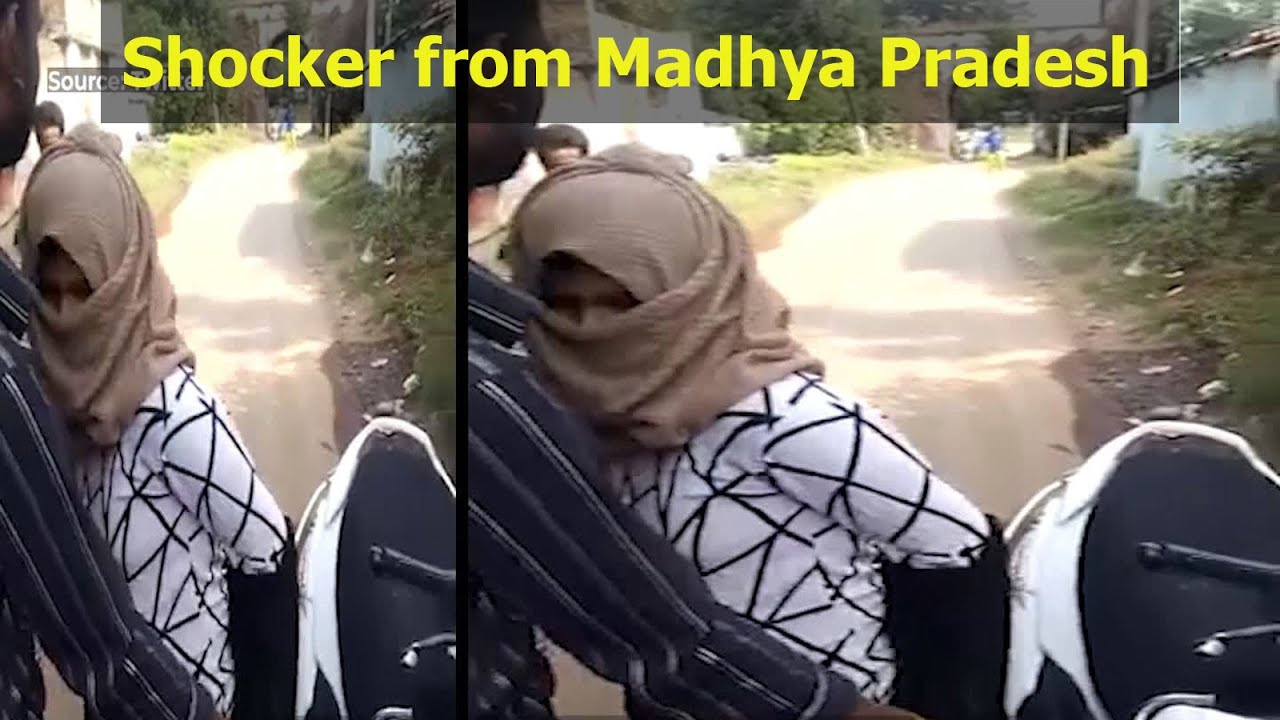 Download Viral video: Woman forced to take off her burqa and hijab by mob in Madhya Pradesh
