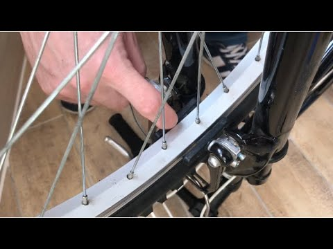 Вопрос: Как исправить виляние велосипедного колеса?