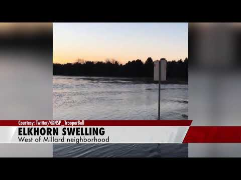 Elkhorn River begins to flood neighborhoods near Omaha, NE