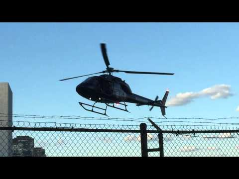 PRIVATE HELICOPTER MAKING A APPROACH & LANDING AT HELIPORT ON 34TH ST. IN KIPS BAY, MANHATTAN, NYC.
