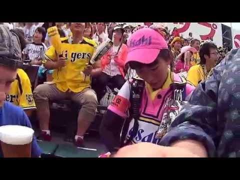 Beer Kegs On Backs Of Beer Vendors At Japanese Baseball Game