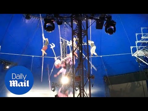 Terrifying moment performers fall during high-wire pyramid act