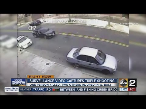 Police release surveillance video showing triple shooting in west Baltimore