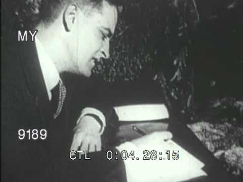 Stock Footage - F. Scott Fitzgerald Writing at a Desk in Paris
