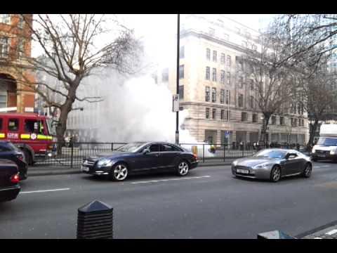 Firemen put out Burning Car on Marylebone road