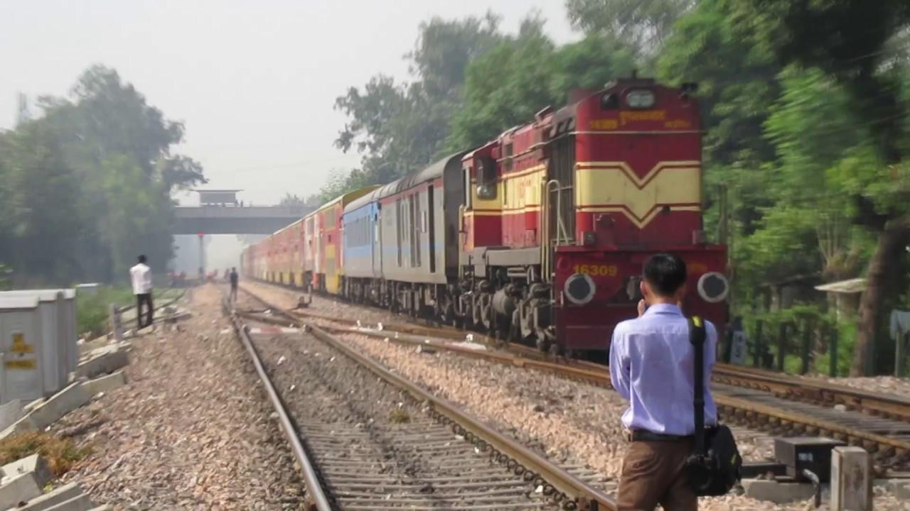 Multi Colour 12985 Jaipur Sarai Rohilla Double Decker Express approaching  Delhi Cantt with an Alco.